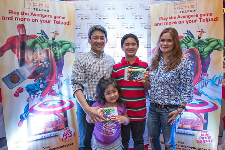 PLDT Executive Vice President and Head of Home Business Ariel P. Fermin (left) with his family