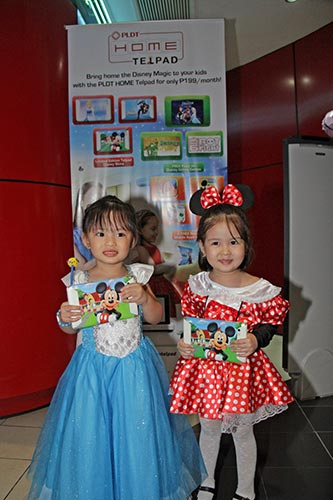 Kids in their favorite costumes with their Mickey Mouse-themed Telpads.