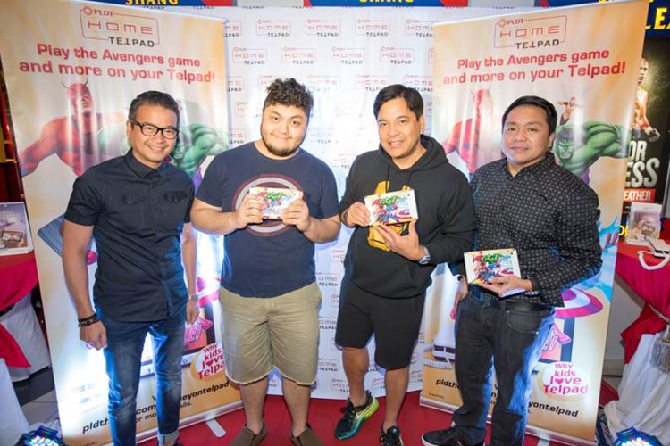 Concert king Martin Nievera (2nd from right) and son Ram (2nd from left) are joined by PLDT Vice President and Home Voice Solutions Patrick Tang (left) and PLDT Vice President and Head of Home Marketing Gary Dujali (right)