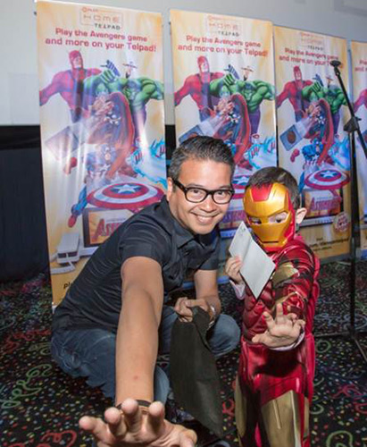 PLDT Vice President and Head of Home Voice Solutions Patrick Tang gets into character with a young superhero.