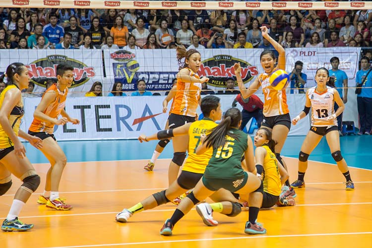 The PLDT Home Ultera Ultra Fast Hitters look on as the Philippine Army Lady Troopers try to save the ball in Game 3 of the Shakey's V-League Open Conference finals at the FilOil Flying V Arena.