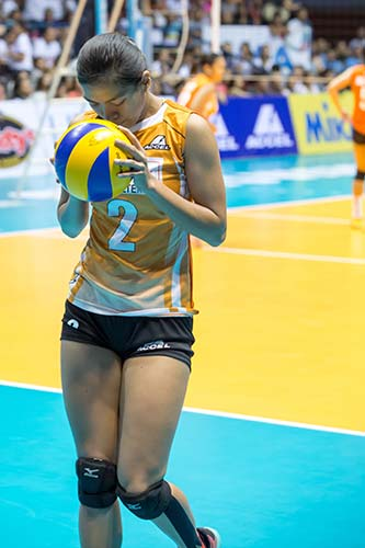 The season's Most Valuable Player Alyssa Valdez took some time to herself and kisses the ball before going to the service line in Game 3 of the Shakey's V-League Open Conference finals.