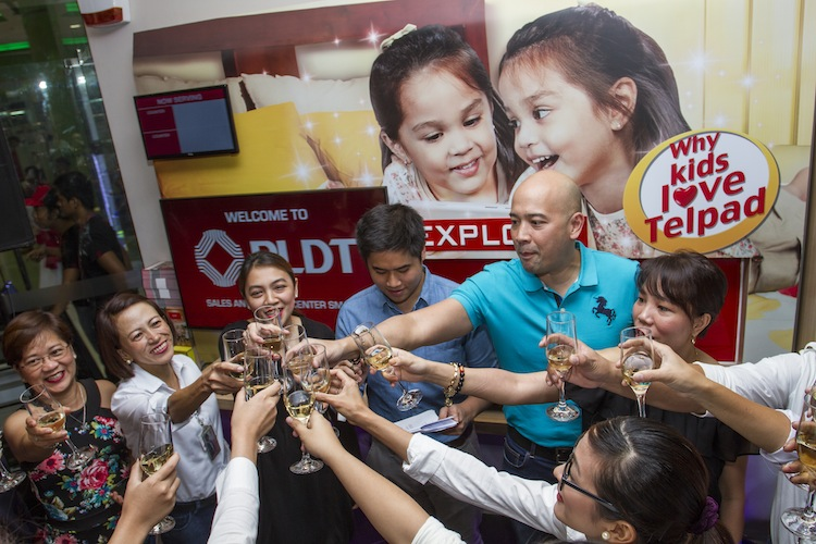 Customer Care Executives and SSC Team share a toast