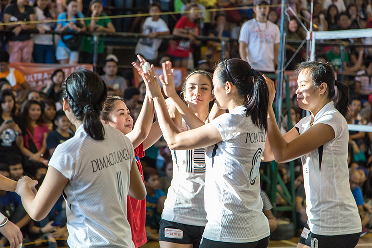 Team Amihan gives the women's team of General Trias high fives after their exhibition game