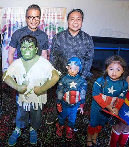 PLDT Vice President and Head of Home Voice Solutions Patrick Tang (left) and PLDT Vice President and Head of Home Marketing Gary Dujali (right) with kids dressed up in their favorite Marvel superhero costumes